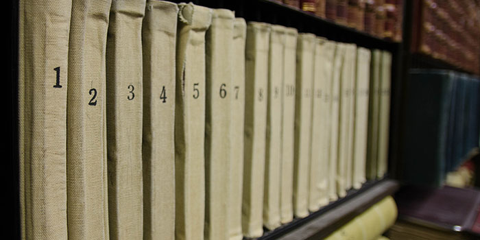 photo of vintage documents on a bookshelf
